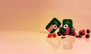 raspberry and cherry gummies with tin concept packaging